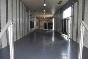 Inside 2nd Floor of Bixby Marching Trailer with Director's Platform, Barn Door Fence and Outside Lighting. Inside lighting is slim to the roof and is unobtrusive.