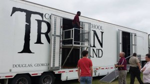 Clubhouse Trailer Company custom Director's Platform with front and side fencing. High School Marching Band Semi Trailer