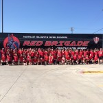 Happy students at Harker Heights High school after the delivery of their new semi Band Trailer!
