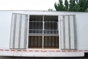 This mesh locking gate increases safety in our marching band trailers.