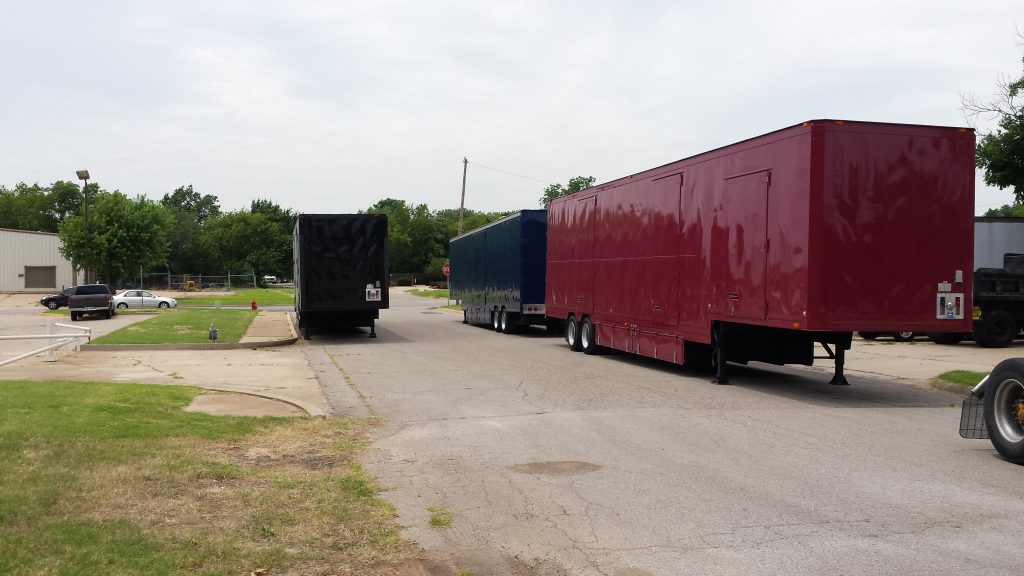 New Painted Semi Trailers awaiting graphics application and interior build-out
