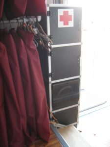 On this side of the Electrical Cabinet is a first aid cabinet, tool storage cabinet, and fuse panel.