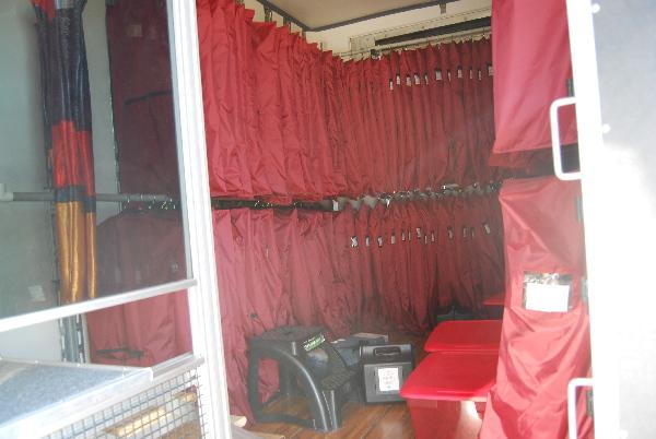 Front Uniform Storage in Edmond Memorial High School's semi trailer. These racks can hold 250+ uniforms.
