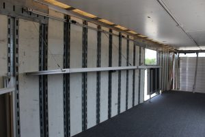 John Horn Band Semi Trailer with Folding Shelves Storage Solution