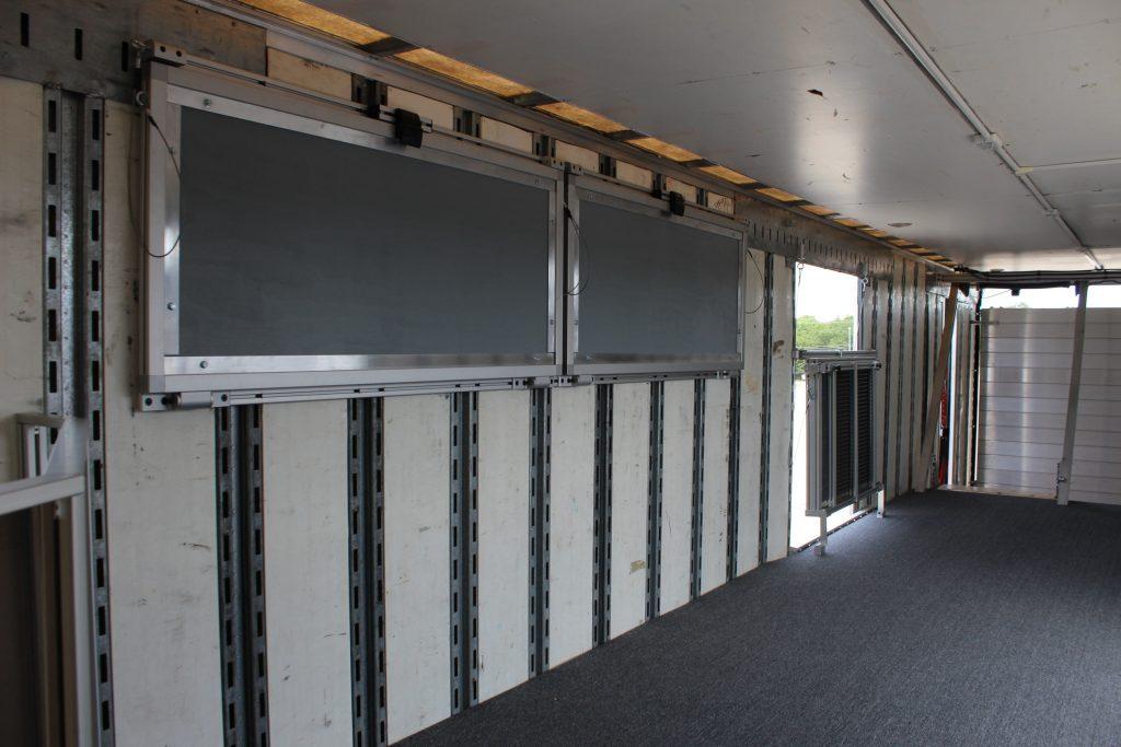 John Horn Band Semi Trailer with Folding Shelves Storage Solution