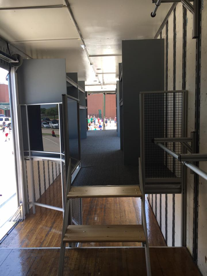 Interior of Lake Dallas High School Marching Band Semi Equipment Trailer. Stairs onto 2nd floor with Custom Instrument Storage and LED Interior Lighting