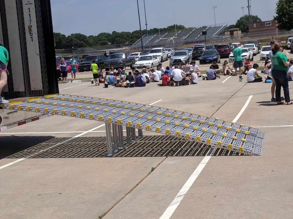 Lake Dallas High School Marching Band Semi Equipment Trailer Aluminum Loading Ramps. These lightweight ramps can roll-up to easily store inside the trailer!