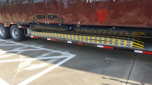 Easy Bellybox Storage of the Aluminum Loading Ramps for a High School Marching Band Semi Trailer