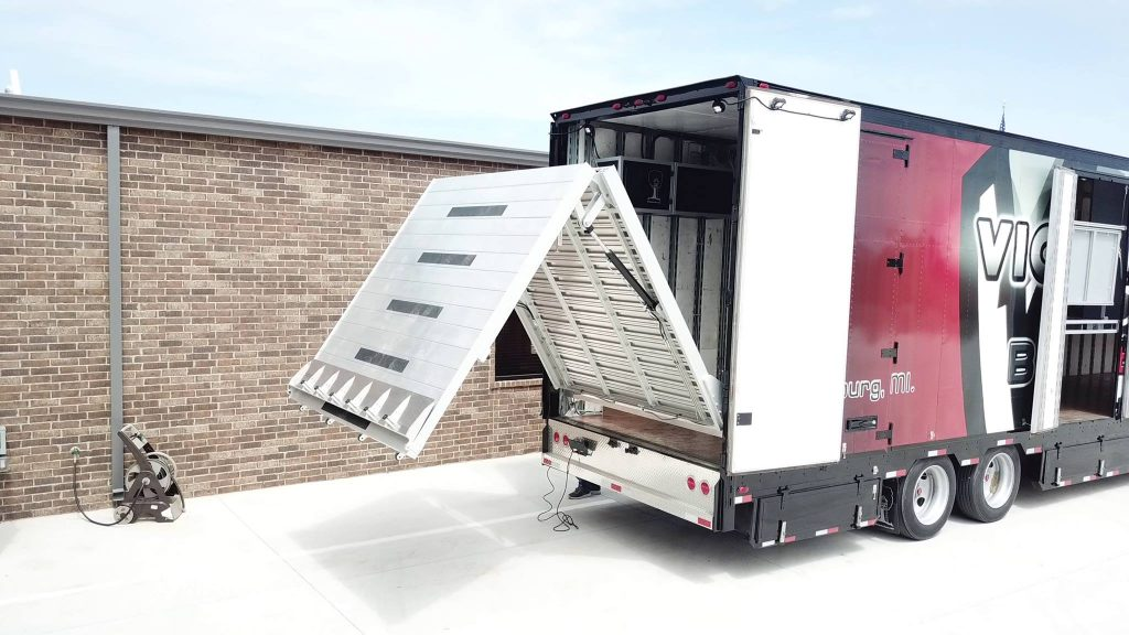 Rear Full-Width Hydraulic Ramp for Marching band semi trailers.